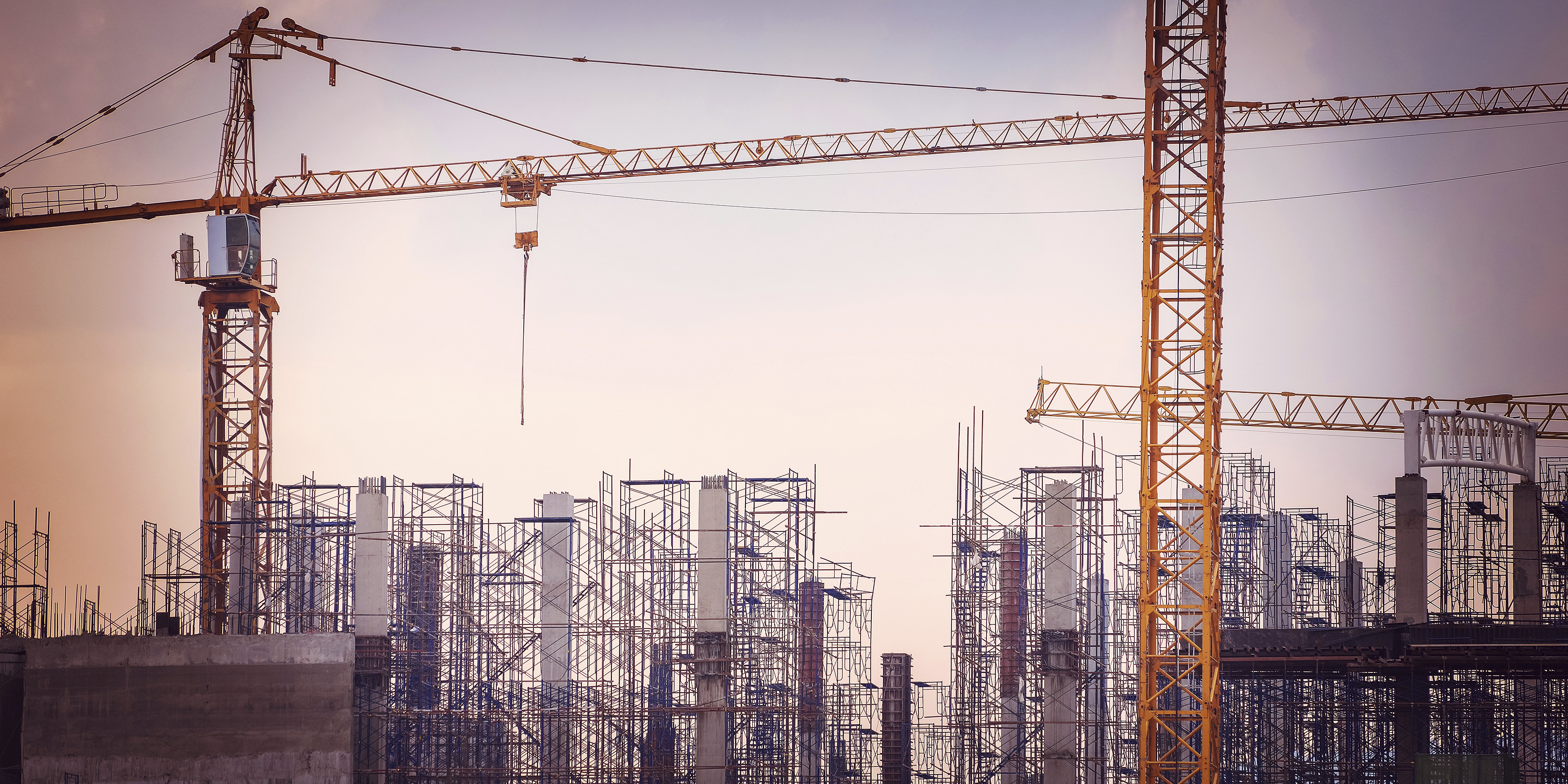 Construction site with cranes on sky background, retro tone image